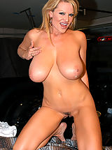 Busty Brunette, Kelly gets picked up off the side of the road and bangs her puss in the back of a truck.