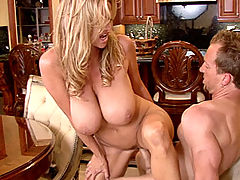 Big Tits Fetish, Kelly strips off her tight white tank top and pulls down her jeans to take a huge cock at the dinner table.