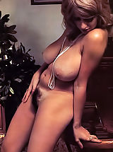 Check out this busty vintage porn star showing her monster boobs & hairy pussy today on the gal of VintageCuties
