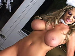 Kelly gets fucked and bounces her tits under the X-Mas tree.