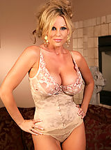 Kelly Madison, Kelly tries on a couple different outfits and shows the tits off.
