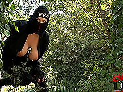 Busty ninja Shione Cooper taking off black dress outdoors