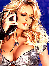 Babes Pics: Stormy Daniels shows off her big tits in this hot solo set.