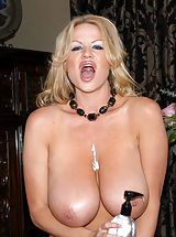 Kelly Madison, Kelly rubs lotion all over her tits and uses lavender vibrator while wearing black gloves.