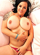 Very Busty, Hot busty Mandy May poses her tattooed & pierced sexy body