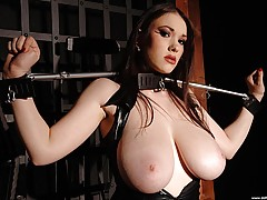 Busty babe Anna Song tied up, in and out of tight latex