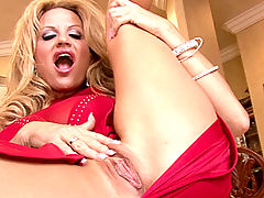 Boobs Movies, Kelly celebrates her 34FF tits in a skintight red dress and masturbates with a blue vibrator.